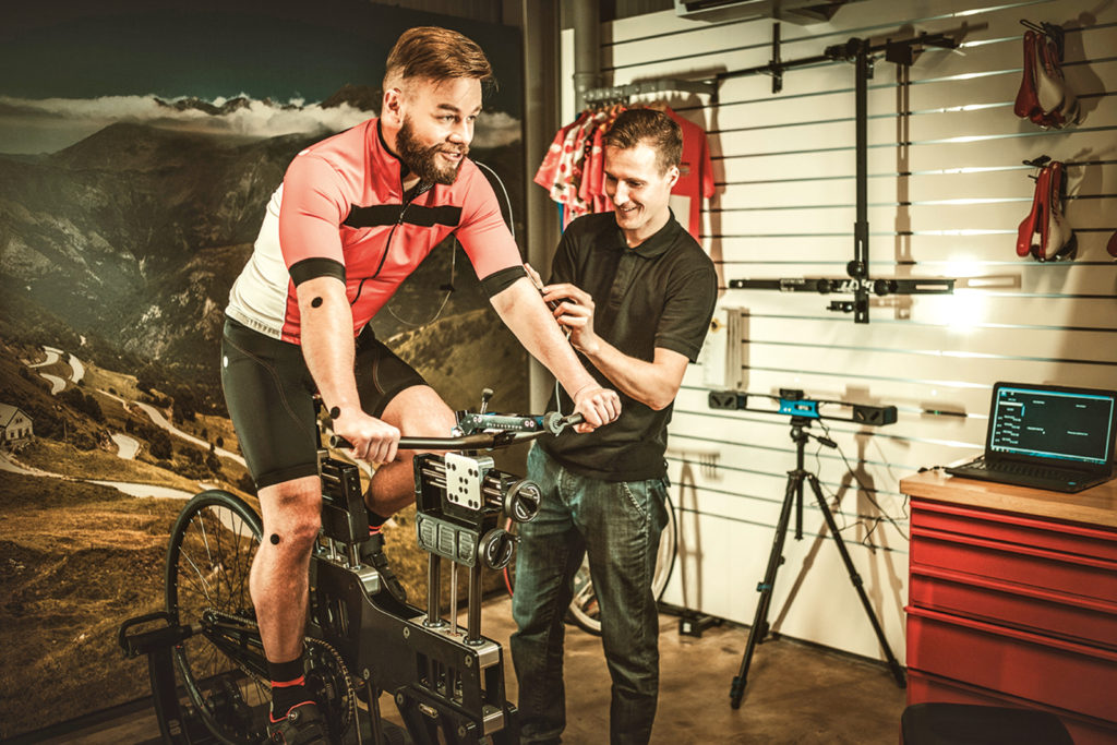 stock-photo-professional-cyclist-being-tested-on-body-geometry-simulator-in-fit-services-397440367
